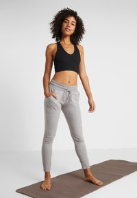 Free People - SUNNY SKINNY - Tracksuit bottoms - grey combo - 1