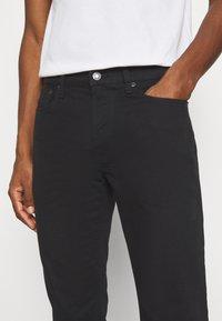GAP - Straight leg jeans - true black - 4