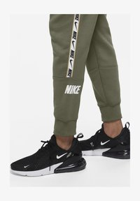 Nike Sportswear - REPEAT - Tracksuit bottoms - medium olive - 5