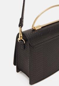 ALDO - SPRIMONT - Handbag - jet black/gold-coloured - 3