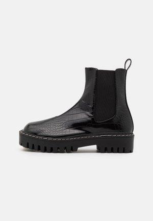 ZINNIA - Platform ankle boots - black