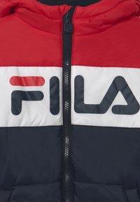Fila - LYNN PUFF UNISEX - Winter jacket - black iris/true red/bright white - 4