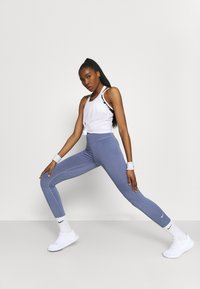 Nike Performance - DRY ELASTIKA TANK - Funktionströja - white/black - 3