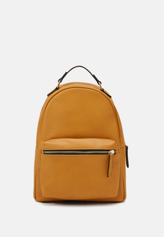 Sac à dos - mustard yellow