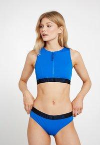 Calvin Klein Swimwear - INTENSE POWER HIPSTER - Bikini bottoms - duke blue - 1