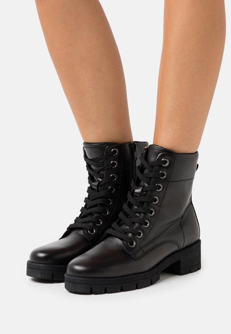 Jana - Platform ankle boots - black