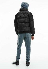 Calvin Klein Jeans - Winter jacket - ck black / mix media - 2