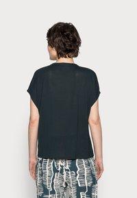 someday. - KANJA - Basic T-shirt - pacific - 2