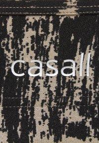 Casall - STRAPPY SPORTS BRA - Medium support sports bra - survive grey - 2