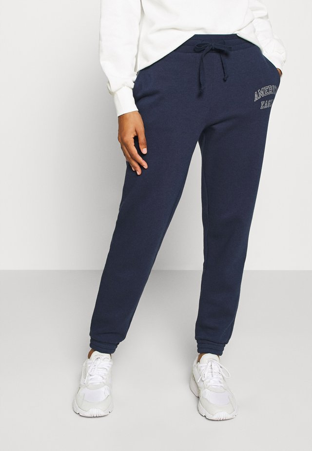 INTERNATIONAL BRANDED - Tracksuit bottoms - navy