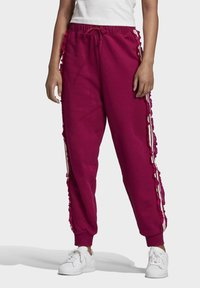 adidas Originals - BELLISTA SPORTS INSPIRED JOGGER PANTS - Tracksuit bottoms - power berry - 0