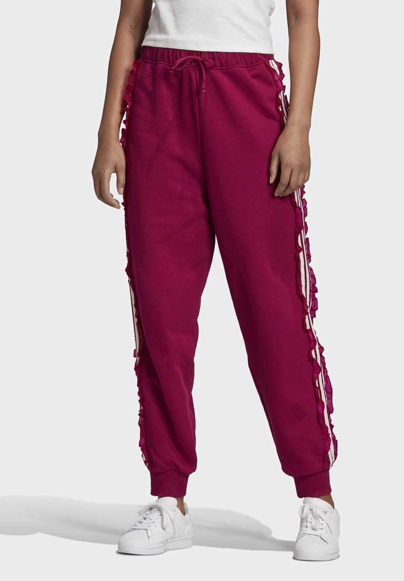 adidas Originals - BELLISTA SPORTS INSPIRED JOGGER PANTS - Tracksuit bottoms - power berry