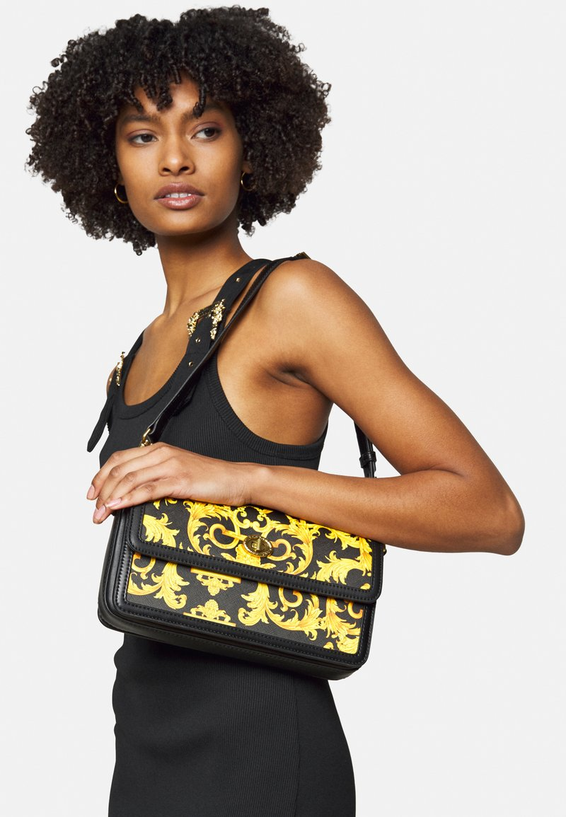 Versace Jeans Couture - LULA BAGUETTE - Handbag - black/dark yellow