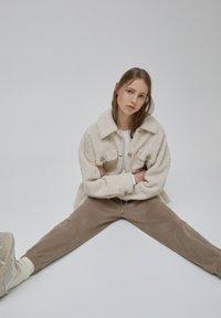 PULL&BEAR - Tracksuit bottoms - beige - 6