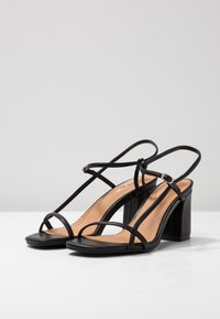 Rubi Shoes by Cotton On - HANNAH THIN STRAP HEEL - Sandaler - black smooth