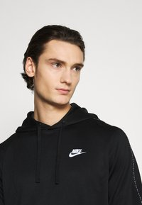Nike Sportswear - REPEAT HOODIE - Long sleeved top - black/reflective silver - 3
