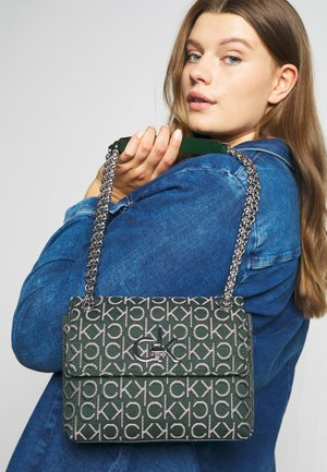 RE LOCK CROSSBODY - Across body bag - green