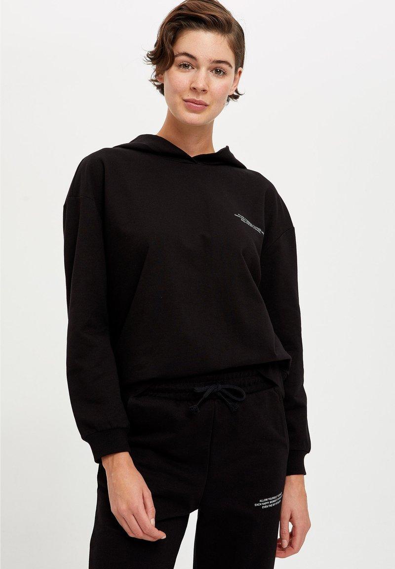 DeFacto Fit - Jersey con capucha - black