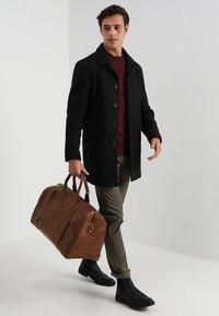 Still Nordic - CLEAN BAG - Weekend bag - brown - 1