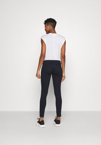 Diesel - SLANDY-LOW-ZIP - Jeans Skinny Fit - dark blue - 2