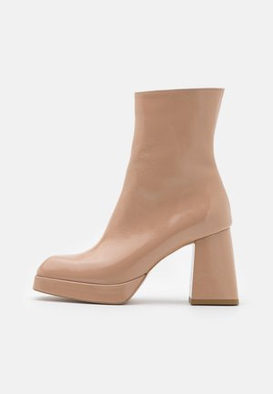 ELECTRO SWING - Platform ankle boots - beige