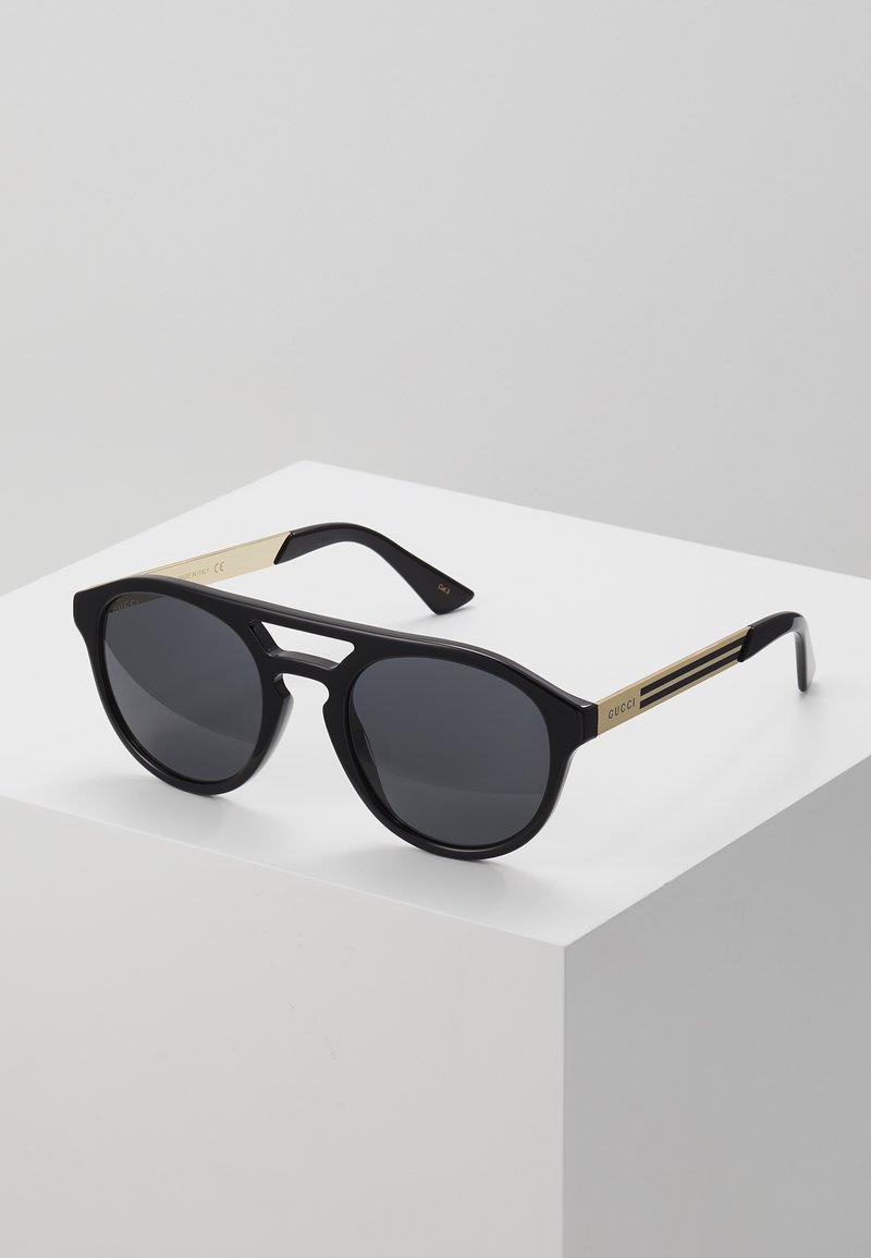 Gucci - Occhiali da sole - black/gold-coloured/grey