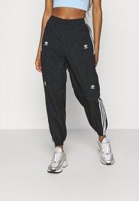 adidas Originals - TRACK PANTS - Tracksuit bottoms - black - 0