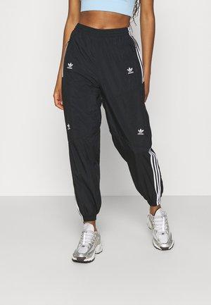 TRACK PANTS - Pantalones deportivos - black