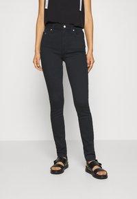 Calvin Klein Jeans - HIGH RISE SKINNY - Jeans Skinny - black denim - 0