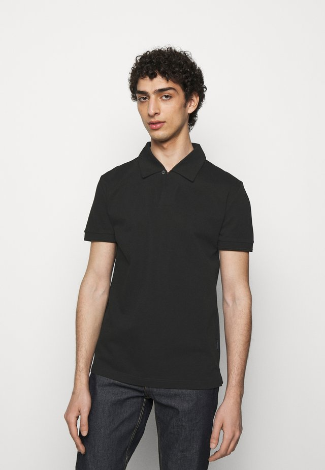 ADERICO - Polo - black