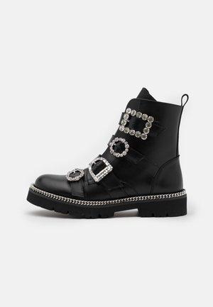 PAGOLA - Cowboy/biker ankle boot - black