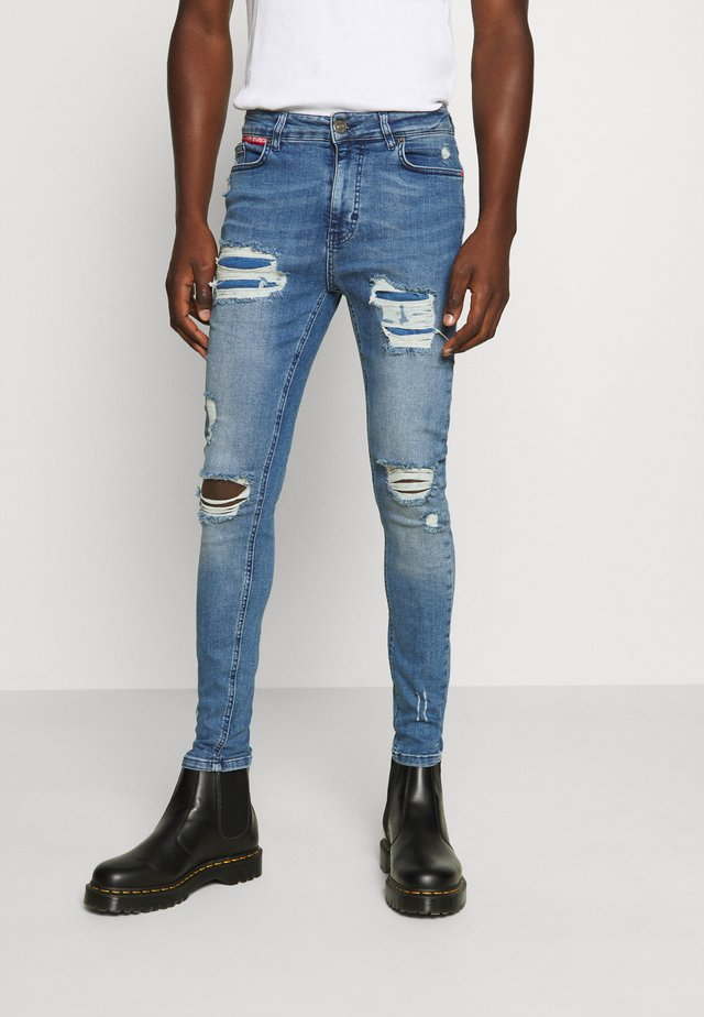 ESSENTIAL SUPER STRETCH DISTRESSED - Jeans Skinny Fit - mid blue wash
