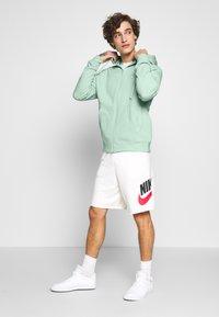 Nike Sportswear - CLUB HOODIE - Zip-up sweatshirt - pistachio frost/white - 1