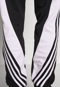 adidas Originals - 3STRIPES WRAP TRACK PANTS - Spodnie treningowe - black/white - 5
