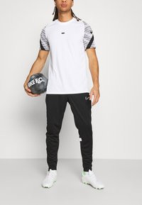 Nike Performance - ACADEMY 21 PANT - Tracksuit bottoms - black/white - 3