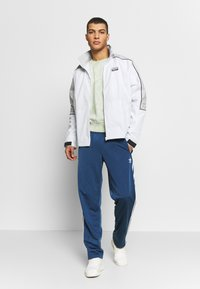 adidas Originals - FIREBIRD ADICOLOR TRACK PANTS - Träningsbyxor - marine - 1