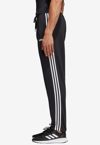 adidas Performance - ESSENTIALS 3STRIPES FRENCH TERRY SPORT PANTS - Tracksuit bottoms - black - 2