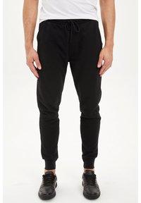 DeFacto - DEFACTO TRACKSUIT BOTTOMS - Spodnie treningowe - black - 0