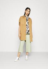 Monki - LUCA BLOUSE - Button-down blouse - white - 1