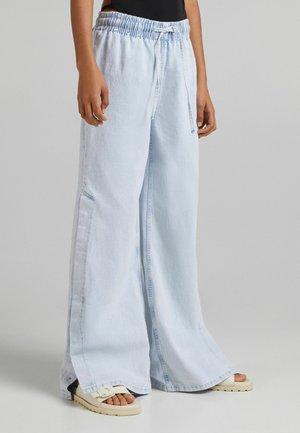 WIDE LEG - Tracksuit bottoms - light blue