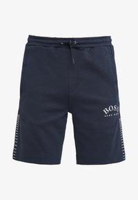 BOSS - HEADLO WIN - Pantalon de survêtement - blue/silver - 4