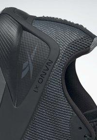 Reebok - NANO X1 GRIT SHOES - Neutral running shoes - black - 9