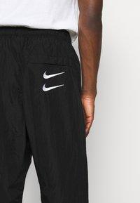 Nike Sportswear - PANT - Pantaloni sportivi - black/white - 4
