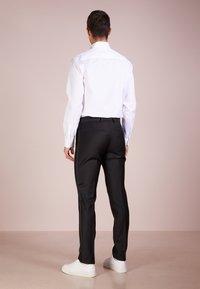 Tiger of Sweden - TERRISS TUXEDO PANTS - Suit trousers - black - 2
