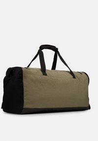 adidas Performance - Sports bag - green/black/white - 2