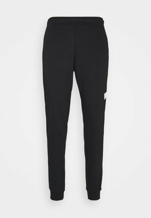 TAPER - Tracksuit bottoms - black/white