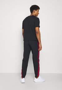 Nike Performance - RUN STRIPE PANT - Trainingsbroek - black/university red/silver - 2