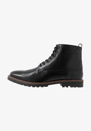 CALLAHAN - Šněrovací kotníkové boty - black