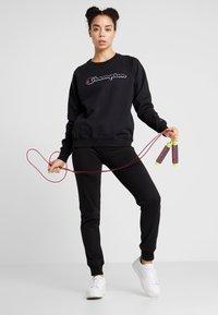 Champion - Sweatshirt - black - 1