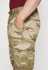 Schott - TROLIMPO - Shorts - beige - 4